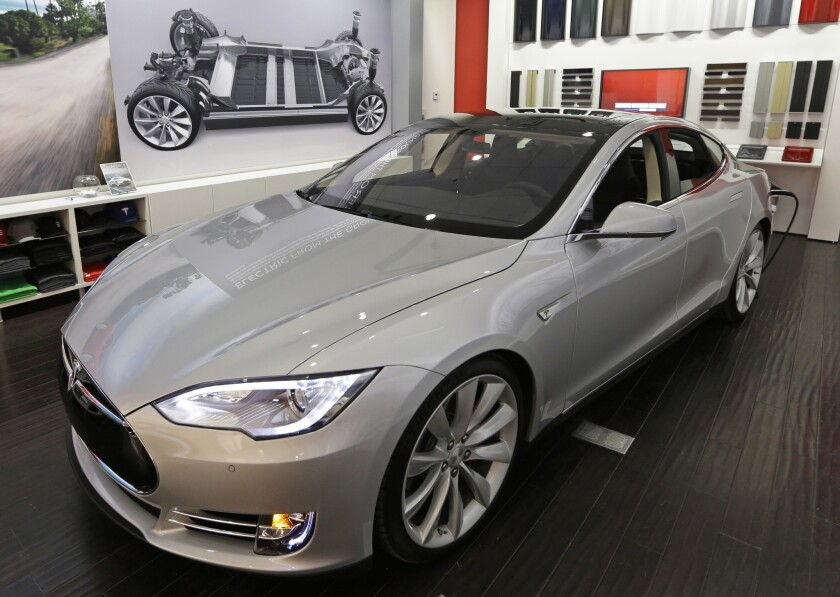 A new Tesla car is on display at a showroom inside the Kenwood Towne Centre in Cincinnati.