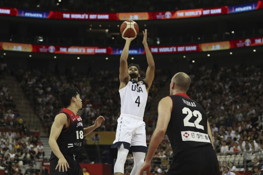 Derrick White of the U.S. shoots near Japan's Yudai Baba, left, and Nick Fazekas during a FIBA World Cup game Sept. 5 in Shanghai.