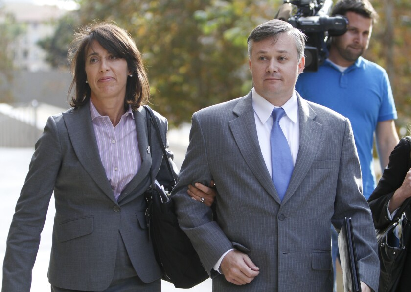 Then-NCIS agent John Beliveau walks into federal courthouse in San Diego with an attorney in 2013.