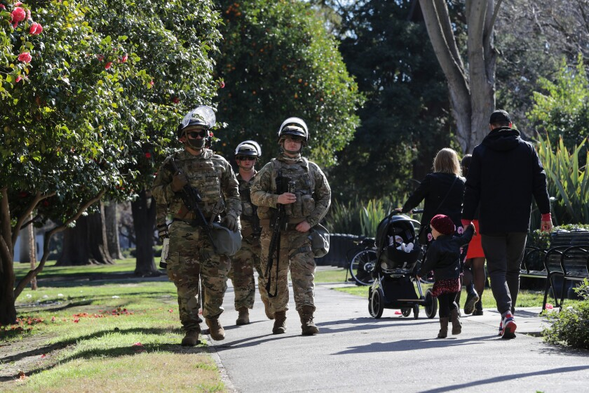 National Guard patrol California State Capitol Park, adjacent to Capitol.
