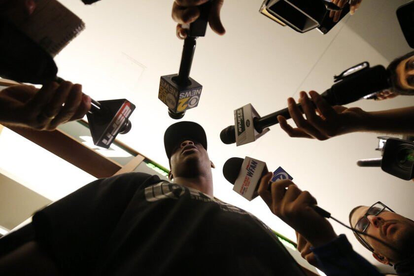 New York Jets quarterback Geno Smith speaks to reporters during an NFL football organized team activity, Wednesday, May 20, 2015, in Florham Park, N.J. (AP Photo/Julio Cortez)