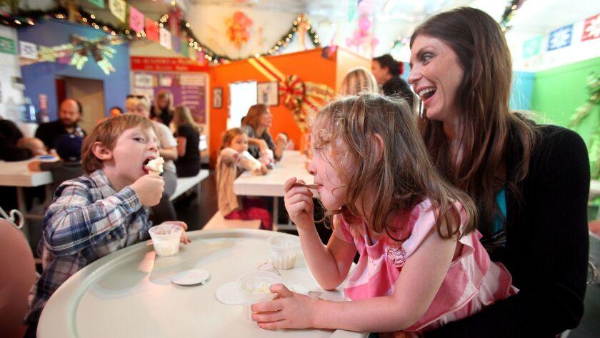 LOS ANGELES, CA-OCTOBER 26, 2012: Nathan Palat, 5, enjoys vanilla ice cream with his sister, Ava, 4