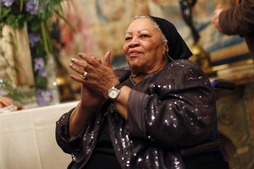 """FILE - In this Sept. 21, 2012, file photo, U.S. novelist Toni Morrison applauds as she attends the America Festival at the U.S. embassy, in Paris. A book of Toni Morrison quotations is coming out in December 2019. """"The Measure of Our Lives: A Gathering of Wisdom"""" will draw from her whole body of work, including such celebrated novels as """"Beloved"""" and """"Song of Solomon."""" The foreword is by Zadie Smith, adapted from a tribute she wrote soon after the Nobel laureate died in August 2019 at age 88. (AP Photo/Thibault Camus, File)"""