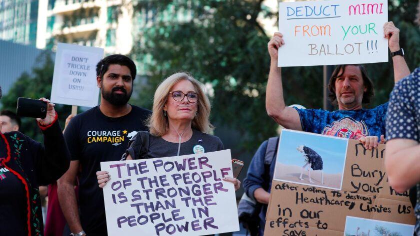 IRVINE, CALIF. -- TUESDAY, DECEMBER 19, 2017: Activist Octavia Toohey, center, who has stage three