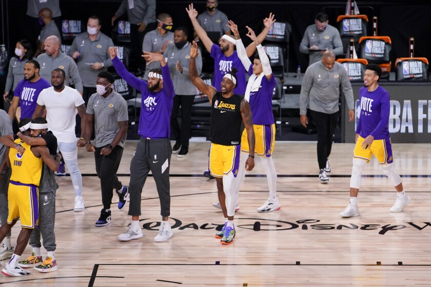 Los Angeles Lakers celebrate their win against the Miami Heat during the second half in Game 4 of basketball's NBA Finals Tuesday, Oct. 6, 2020, in Lake Buena Vista, Fla. (AP Photo/Mark J. Terrill)