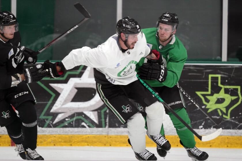 Dallas Stars center Tyler Seguin (91) skates against teammates center Radek Faksa (12) and defenseman John Klingberg (3) during an NHL hockey practice in Frisco, Texas, Thursday, Sept. 23, 2021. (AP Photo/LM Otero)