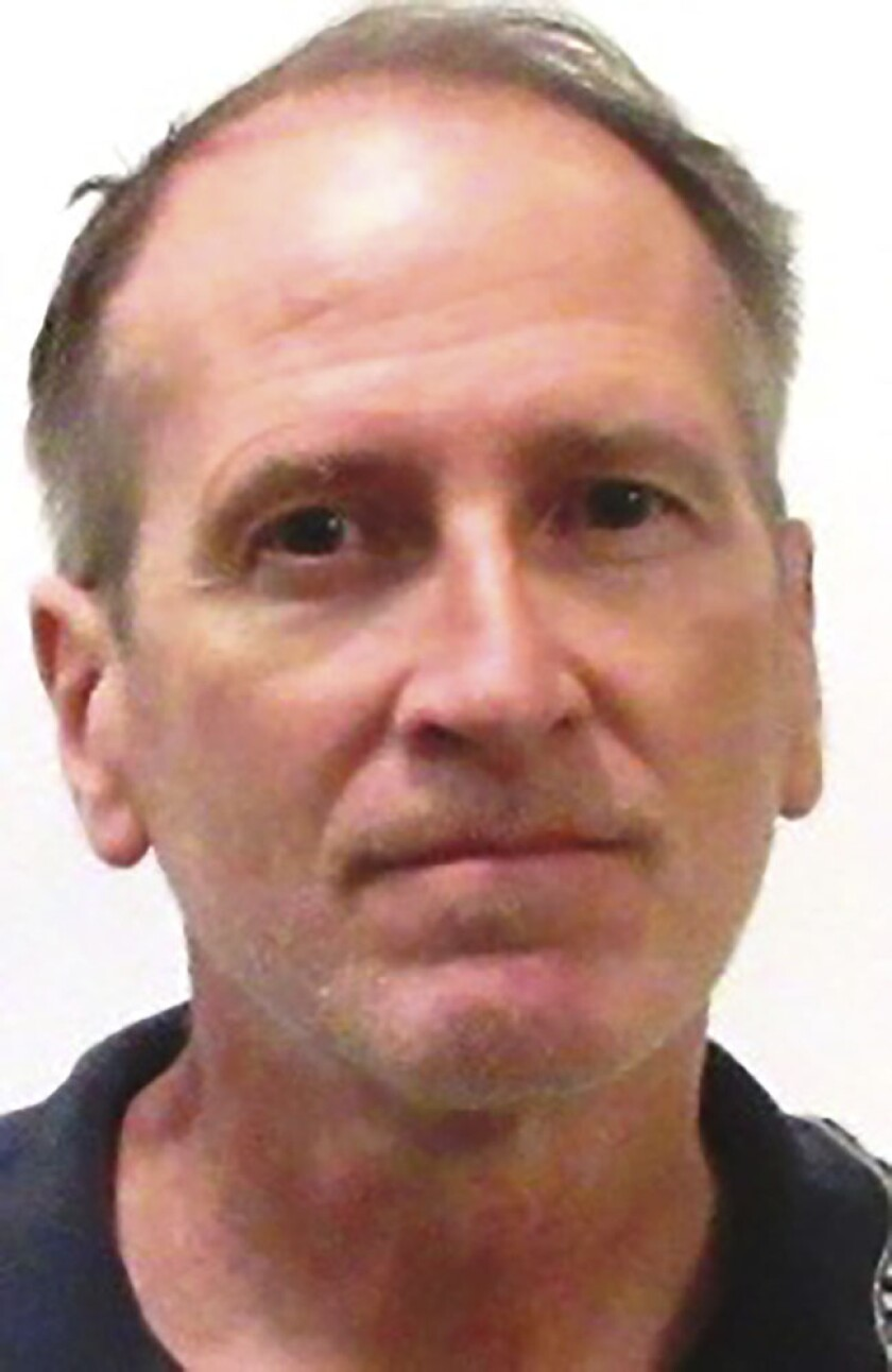 This undated photo provided by the Iowa Department of Corrections shows Kenneth Kerr. The Iowa board responsible for approving lawsuit settlements on behalf of the state decided on a $900,000 settlement in a case filed by three men who worked at the Department of Revenue and claimed they were harassed by Kerr. The lawsuit was filed in 2017 by Daniel Wagner, Lloyd Lofton and Joshua Bates. They claim Kenneth Kerr stalked them and invaded their privacy. (Iowa Department of Corrections via AP)