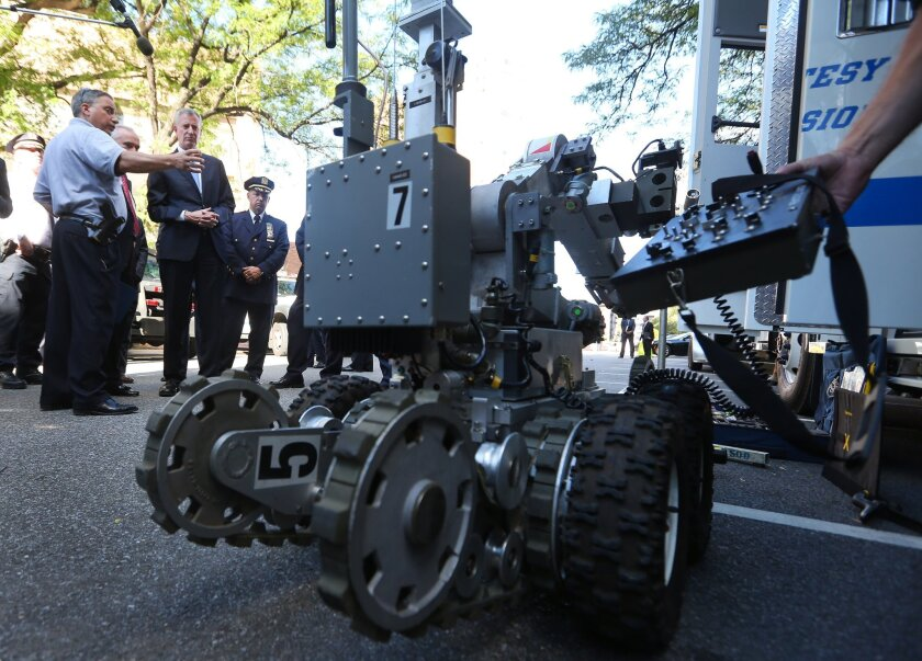 New York City Mayor Bill de Blasio and NYPD Commissioner William J. Bratton inspect special security equipment that will be available during next week's visit by Pope Francis. The city also will host 170 world leaders for the United Nations General Assembly and a free Beyonce concert in Central Park.
