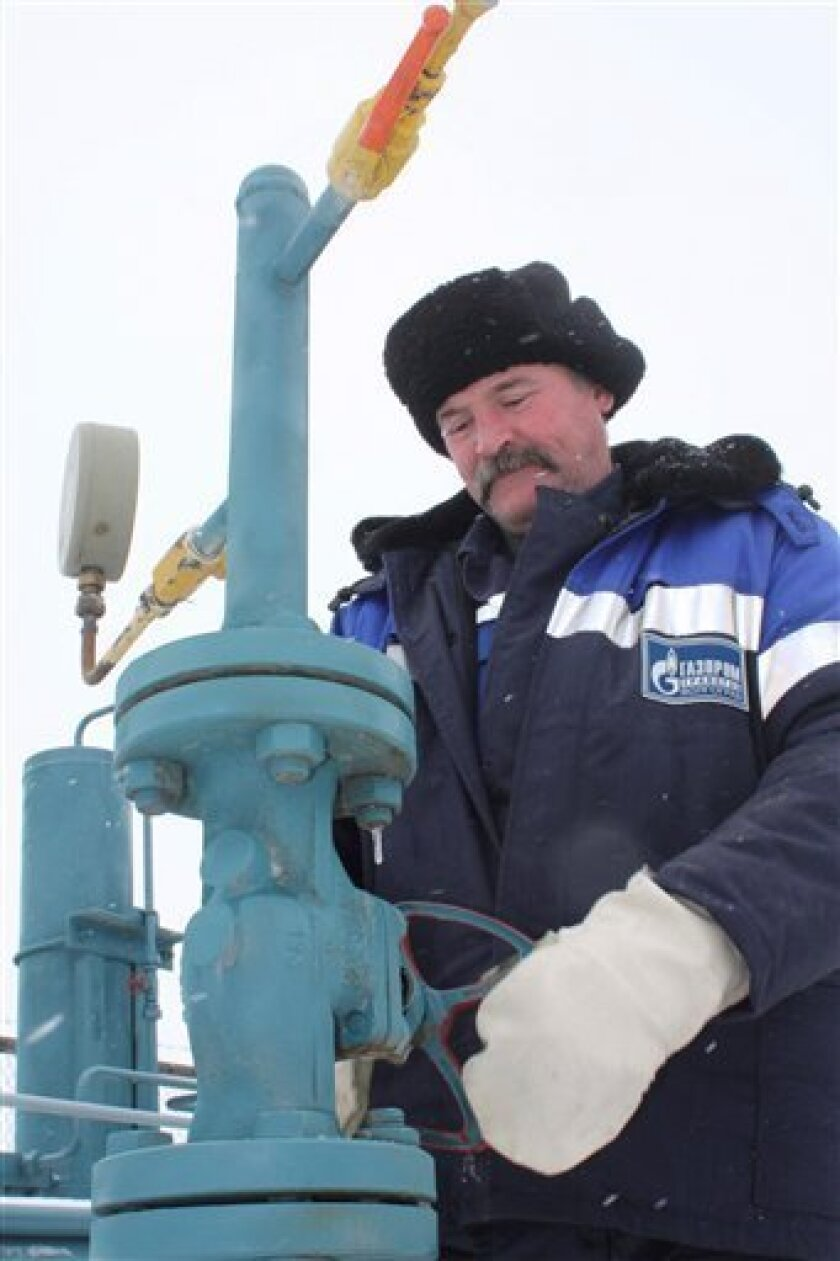 A technician inspects pipeline equipment and gas pressure at the gas metering station in Pisarevka, Russia, on the border with  Ukraine, Tuesday, Jan. 20, 2009. Russian natural gas began flowing Tuesday into Ukraine after a nearly two-week cutoff that left large parts of Europe cold and dark and un