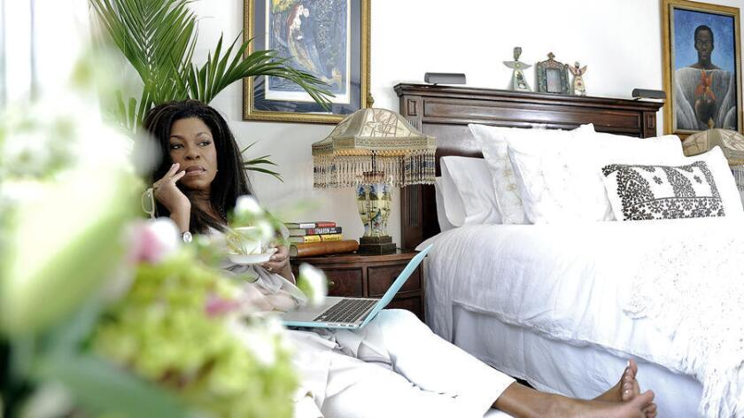 Lorraine Toussaint starts her day with tea service and ends it in luxurious bedding.