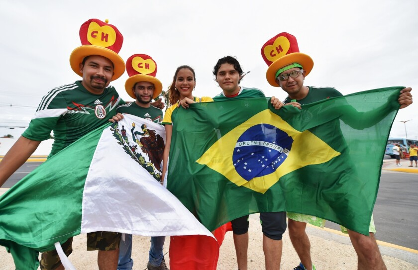Mexico and Brazil fans show support before the 2014 FIFA World Cup Brazil Group A match between Brazil and Mexico at Castelao on Tuesday.