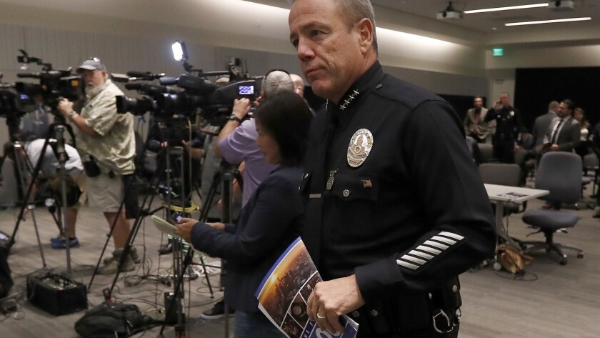 LAPD Chief Michel Moore arrives for a news conference about his first 100 days as the city's top cop.