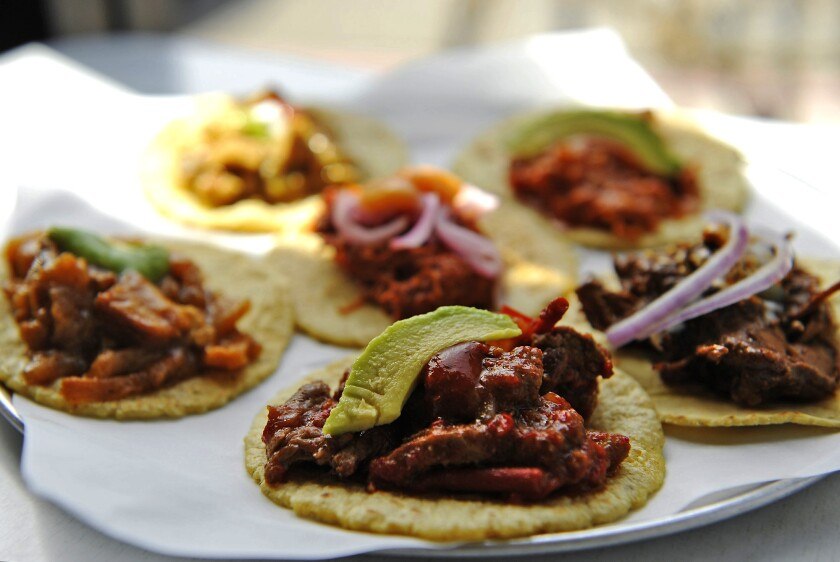 The taco sampler at Guisados, six small tacos prepared so you don't have to make hard decisions.