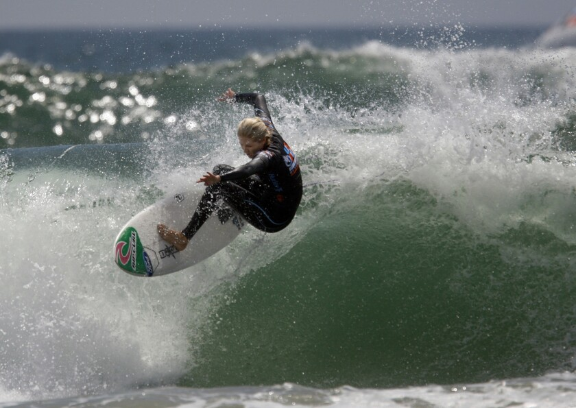 Stephanie Gilmore of Australia surfs at the U.S. Open in Huntington Beach in 2010. A new ad she appears in has sparked controversy.