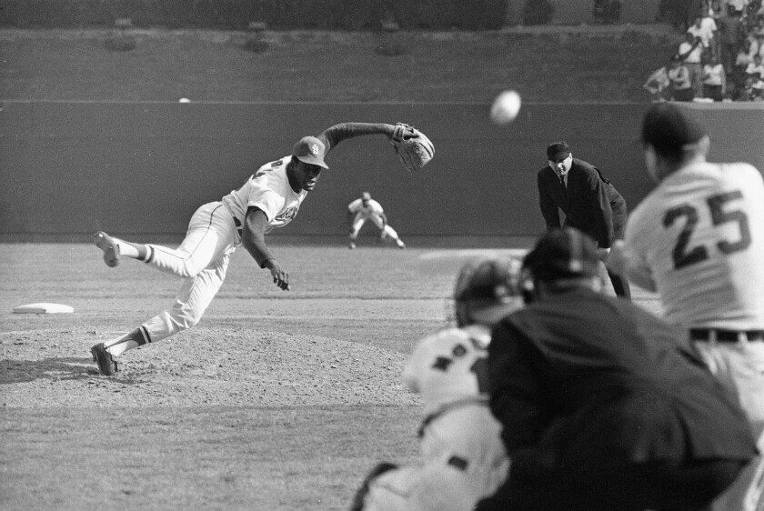 FILE - In this Oct. 2, 1968, file photo, St. Louis Cardinals ace pitcher Bob Gibson throws to Detroit Tigers' Norm Cash during the ninth inning of Game 1 of the baseball World Series at Busch Stadium in St. Louis. Gibson, the dominating pitcher who won a record seven consecutive World Series starts and set a modern standard for excellence when he finished the 1968 season with a 1.12 ERA, died Friday, Oct. 2, 2020. He was 84. (AP Photo, File)