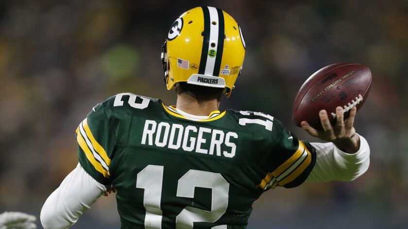 Green Bay Packers quarterback Aaron Rodgers throws during the second half of an NFL football game ag