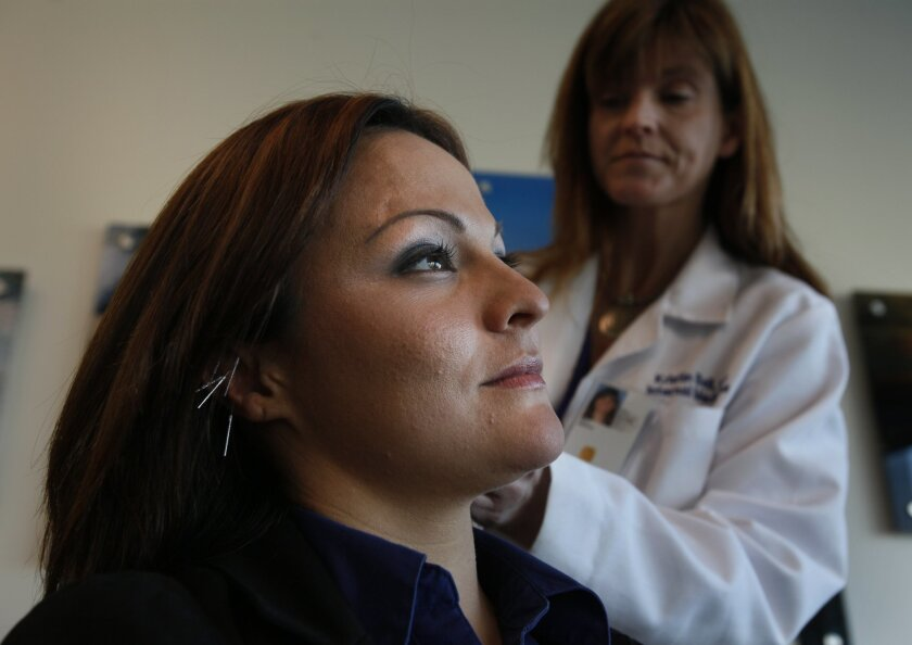 Stephanie Taborda is an recent veteran who gets acupuncture regularly at the VA Clinic in Oceanside. Dr. Kristin Bell treats several veterans in a group therapy class, usually accessing areas of chronic pain through the ears.