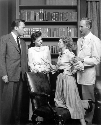 "This image is taken from the premiere TV broadcast of ""Guiding Light"" on June 30, 1952. Pictured are actors Herb Nelson as Joe Roberts, Ellen Demming as Meta Bauer Roberts, Susan Douglas as Joe's daughter Kathy, and Lyle Sudrow as Bill Bauer, Meta's brother. The show, which began airing on the radio in 1937, would also continue several more years of radio broadcasts."