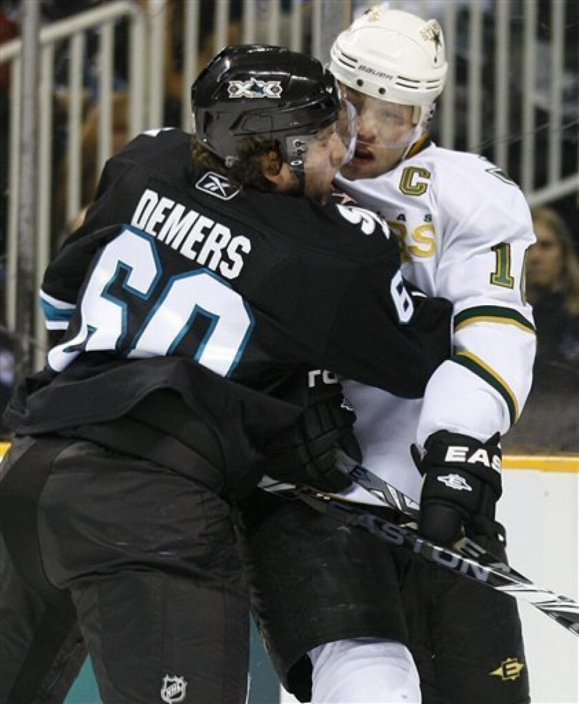 San Jose Sharks' Jason Demers, left, checks Dallas Stars' Brenden Morrow during the second period of an NHL hockey game Thursday, March 31, 2011, in San Jose, Calif. (AP Photo/Ben Margot)