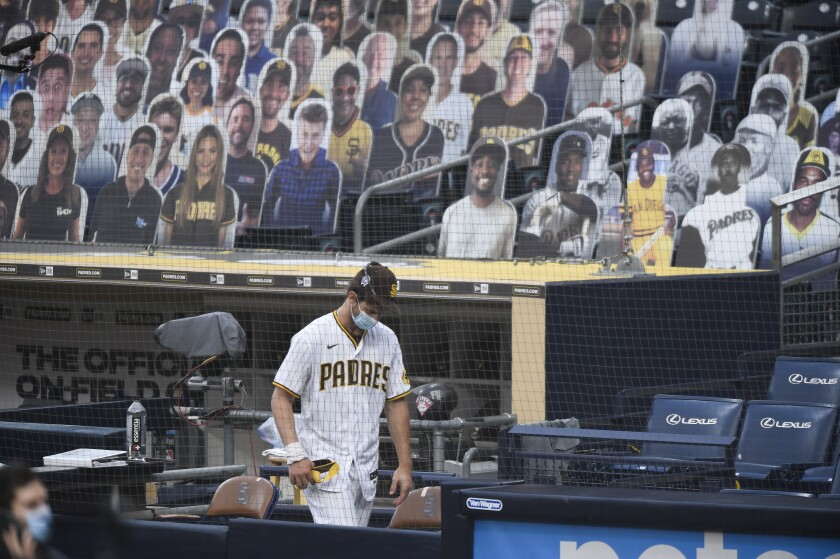 Wil Myers of the Padres walks in dugout before a scheduled game against the San Francisco Giants on Friday at Petco Park.