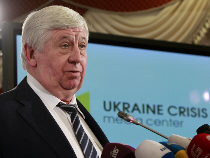 FILE - In this Feb. 16, 2015 file photo, General Prosecutor of Ukraine Viktor Shokin speaks during news conference in Kiev, Ukraine. Ukrainian authorities say a sniper shot at the country's top prosecutor as he sat in his office, but that bulletproof glass prevented any casualties. Prosecutor-Gener