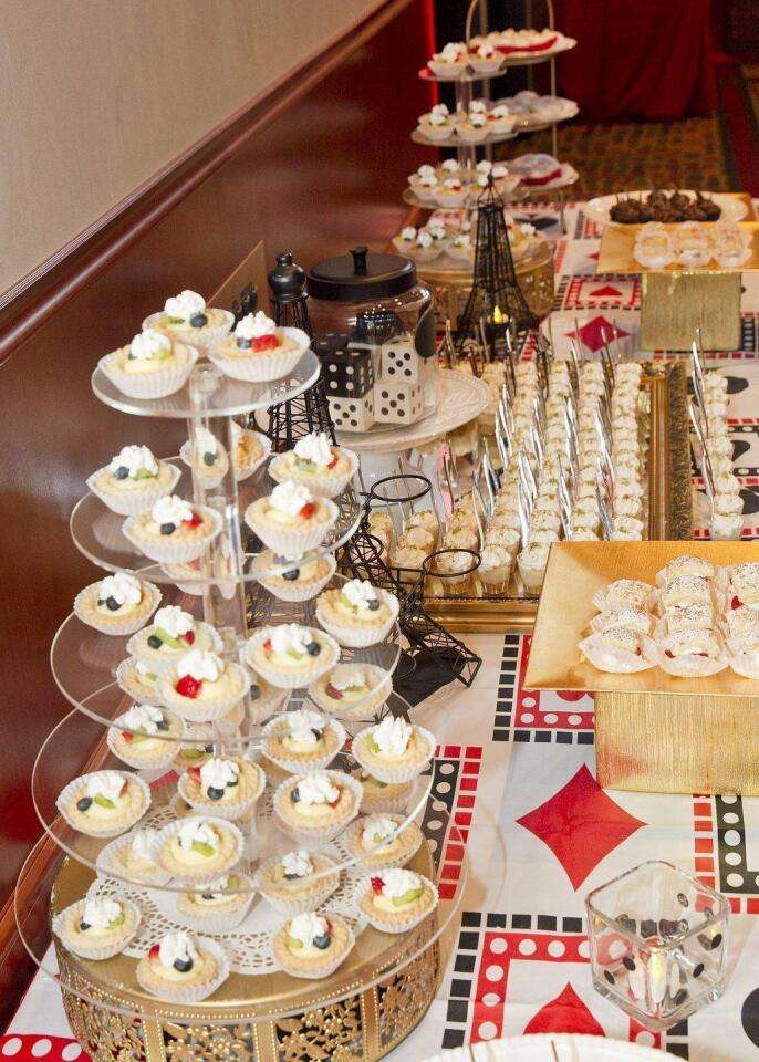 The casino-themed dessert table