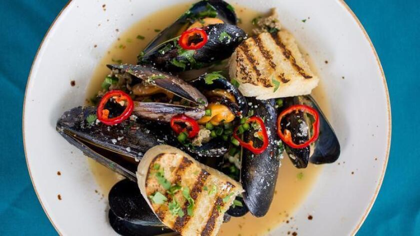 Mussels with green chorizo, chilies, jalapeño from Pueblo in Pacific Beach (Arlene Ibarra)