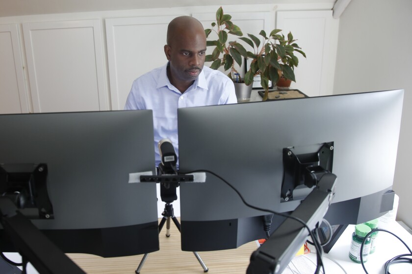 A man works in his home office.