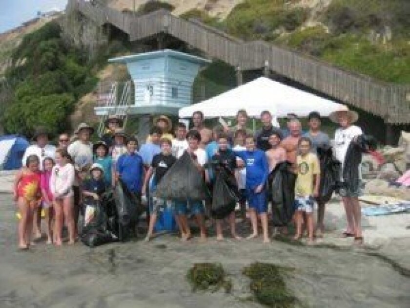Each year after Labor Day, La Jolla Boy Scout Troop 506 organizes its Family Surf Camp at San Elijo campground in Cardiff. This year, Sept. 7-9, some 55 troopers enjoyed the weekend of unusual warm weather, learning ocean skills to earn 'Waterman' patches, and sharing jokes and s'mores around the c