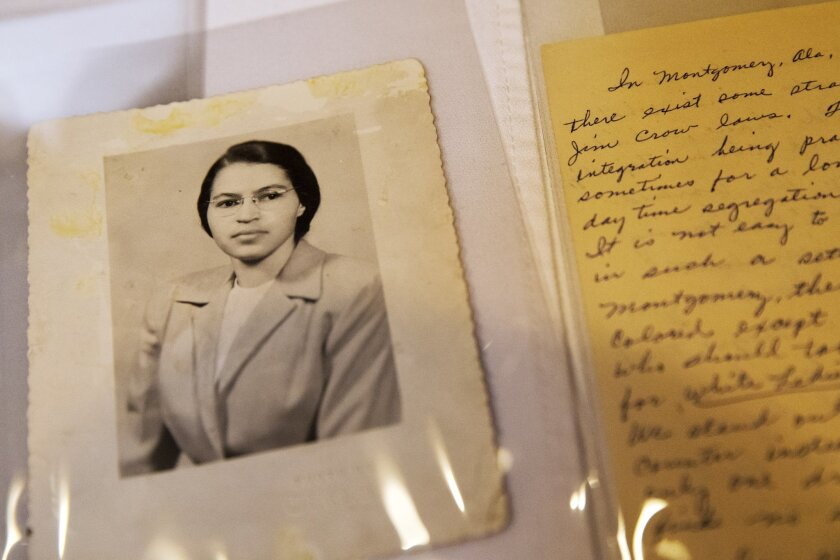 A photo of Rosa Parks from the 1950s and a paper written by Parks about segregation are some of the items in the Rosa Parks archive.