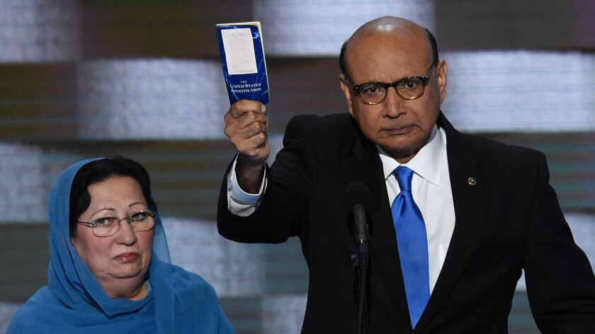 Khizr Khan, with his wife Ghazala Khan, with his personal copy of the U.S. Constitution