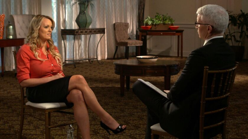 "An image released by CBS News shows Stormy Daniels, left, being interviewed by Anderson Cooper, which aired Sunday on ""60 Minutes."""