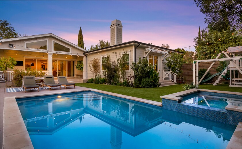 The single-story home includes a private backyard with a swimming pool, spa and playground.