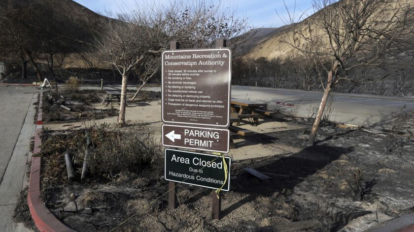 In this Tuesday, Nov. 13, 2018 photo, a sign near the entrance to the Corral Canyon Park recreation