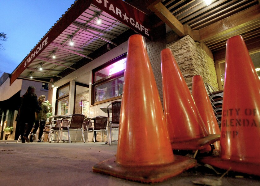 Safety cones cover an area in front of the Star Cafe in Montrose where a 65-year-old man crashed his car into the restaurant's patio on Monday. No one was injured, police said.