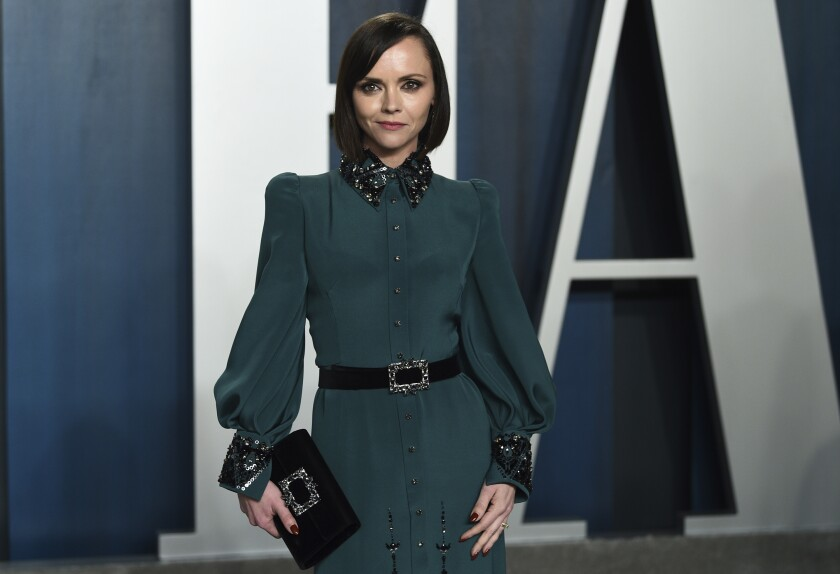 FILE - In this Feb. 9, 2020 file photo, Christina Ricci arrives at the Vanity Fair Oscar Party in Beverly Hills, Calif. The actress has filed for divorce from her husband of nearly seven years. Ricci filed documents in Los Angeles County Superior Court on Thursday to dissolve her marriage with James Heerdegen. (Photo by Evan Agostini/Invision/AP, File)