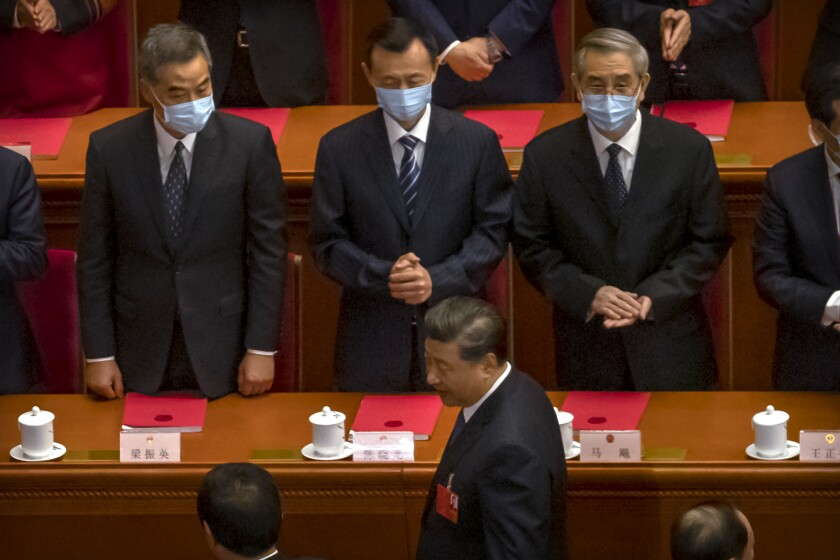 Former Hong Kong leader C.Y. Leung, left, and other delegates greet Chinese President Xi Jinping, foreground, on May 28, 2020.