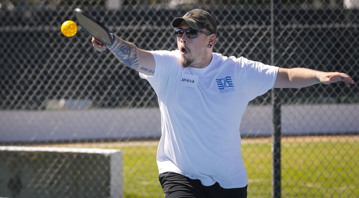 Joshua O'Nan of Santee, a former Marine Corps lance corporal who served in Iraq and received the Purple Heart, is blind and deaf on his left side, and suffered other physical injures, was one of the former and current military service members to participate in the Wounded Warrior Project Pickleball Fest at the San Diego Tennis and Racquet Club.