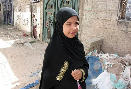 Nujood Ali, 10, stands near her home on the outskirts of Sana, Yemen. Her father gave Nujood's hand in marriage to a man three times her age.