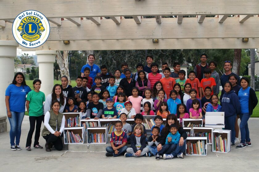 More than 75 elementary, middle, and high school After School Club members were in attendance when the Lions brought 14 boxes filled with books. Courtesy photo