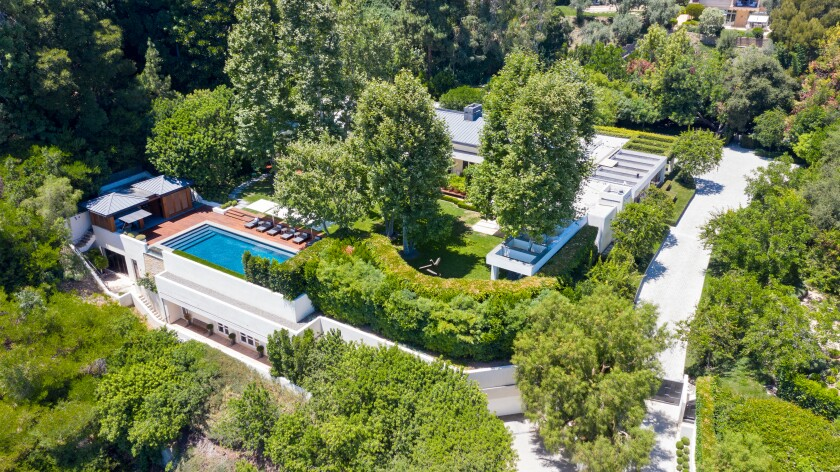 The contemporary compound includes a 9,000-square-foot mansion, two guesthouses, a swimming pool and reflecting pond.