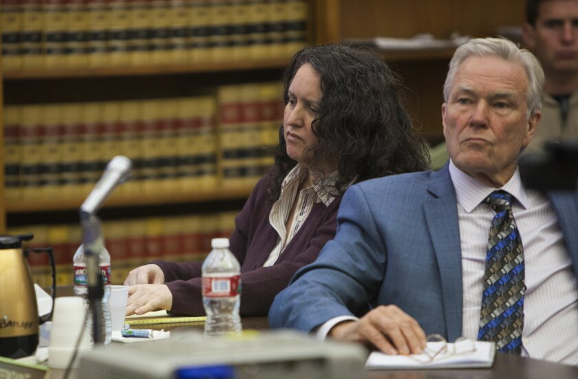 Denise Goodwin (left) and her lawyer Ronald Bobo (right) listen to the prosecutor's opening statement in her Superior Court trial.