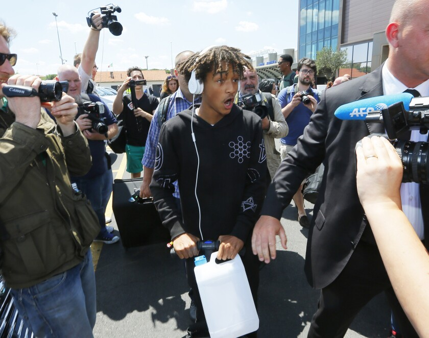 Jaden Smith arrives at the airport Saturday in Florence, Italy, on his way to the wedding of Kim Kardashian and Kanye West -- which he would attend in a white Batsuit.
