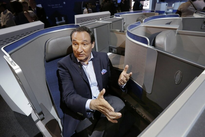 United Airlines CEO Oscar Munoz speaks Thursday, June 2, 2016, in New York, during an interview while seated in the seating configuration of the carrier's new Polaris service, a new business class product that will become available on trans-Atlantic flights. (AP Photo/Richard Drew)