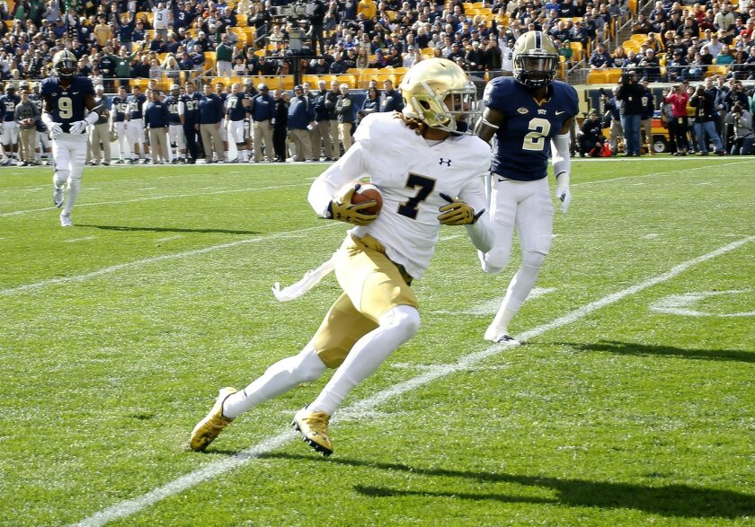 Notre Dame wide receiver Will Fuller (7) runs past Pittsburgh defensive back Terrish Webb (2) after making a catch and running it for a touchdown in the first quarter of an NCAA football game, Saturday, Nov. 7, 2015, in Pittsburgh. (AP Photo/Keith Srakocic)