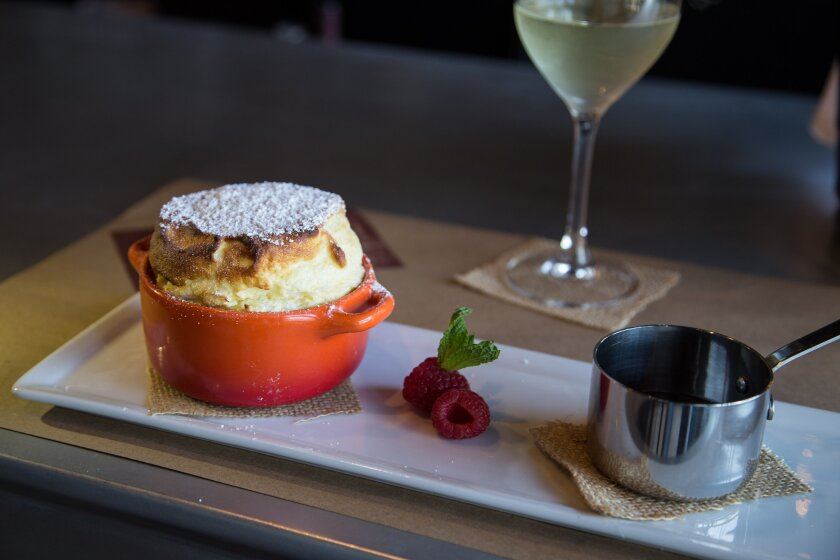 The signature dessert at North Park's imminently charming Et Voilà is the elegant soufflé.