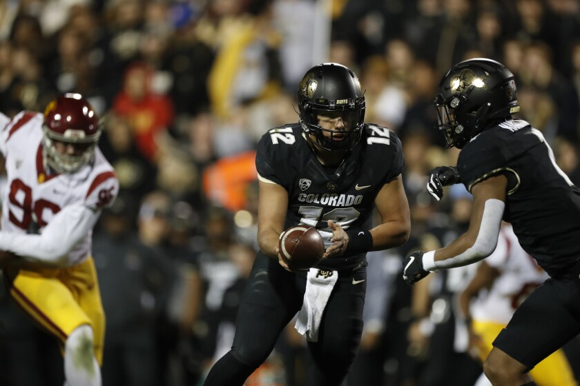 Colorado quarterback Steven Montez hands the ball off in the second half against USC on Oct. 25 in Boulder, Colo.