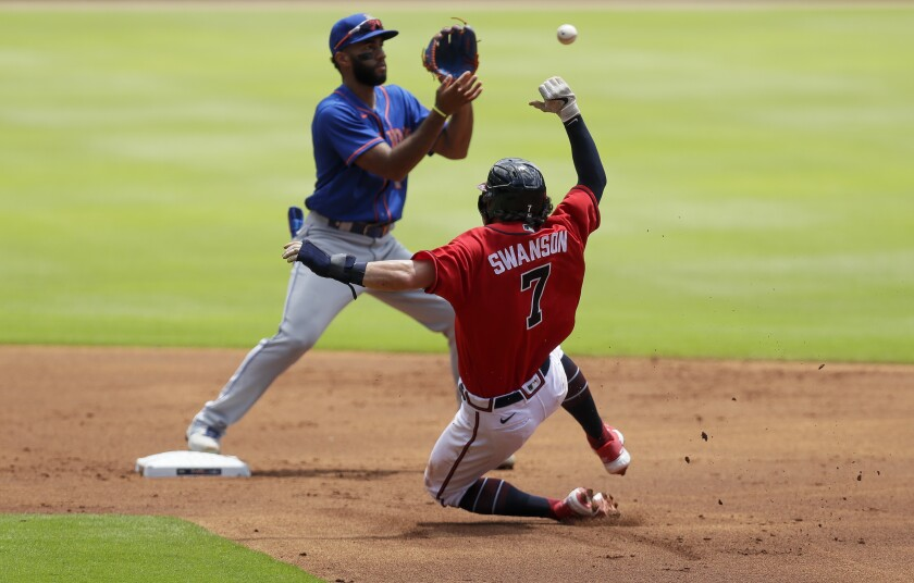 New York Mets' Amed Rosario, left, forces out Atlanta Braves' Dansby Swanson (7) at second base in the first inning of a baseball game Sunday, Aug. 2, 2020, in Atlanta. (AP Photo/Brynn Anderson)