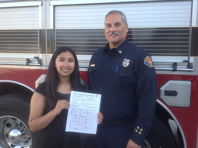 Fire Prevention Week contest winner Tanya Barrera and Escondido Fire Chief Rick Vogt.