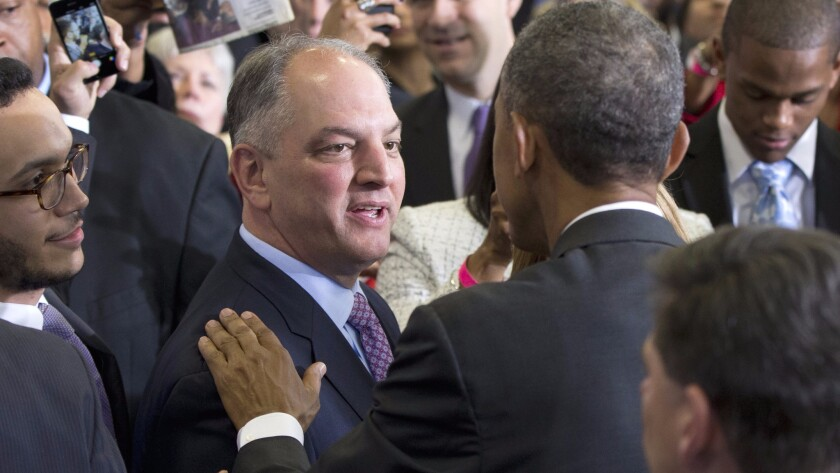 President Obama greets Louisiana Gov. John Bel Edwards after a Baton Rouge town hall in January, at which he praised the newly-elected governor for expanding Medicaid.